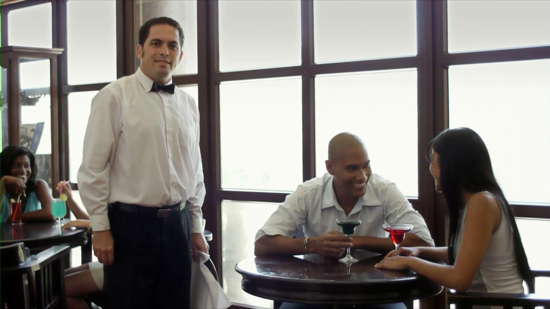 Waiter upselling customer at restaurant